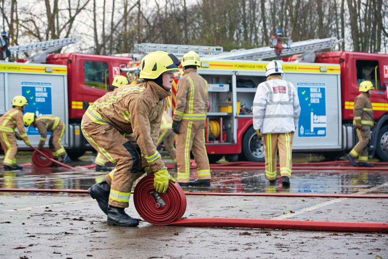 On-Call firefighters showcasing their new skills to family and friends during their Passing Out Parade.