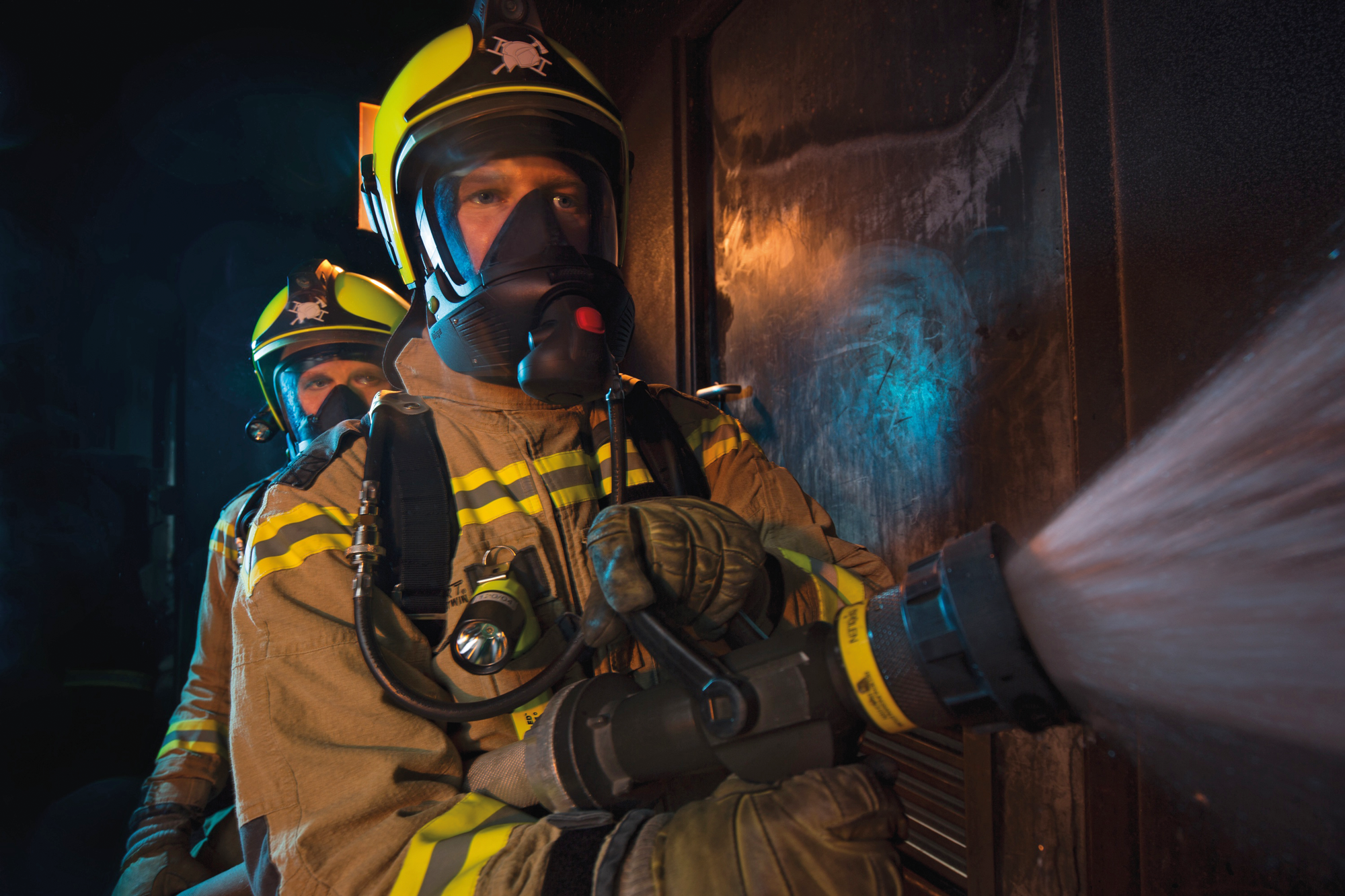 Firefighters wearing breathing apparatus from Dräger.