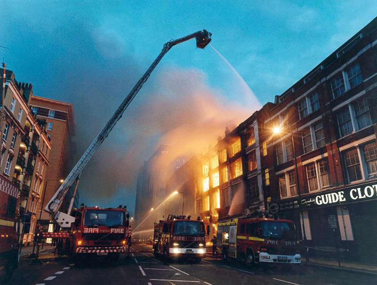 This dramatic night-time image of firefighting operations in progress during an eight-pump fire in a commercial premises in East London highlights the possible post-fire legal disputes over fire-protection standards that are described in this article.