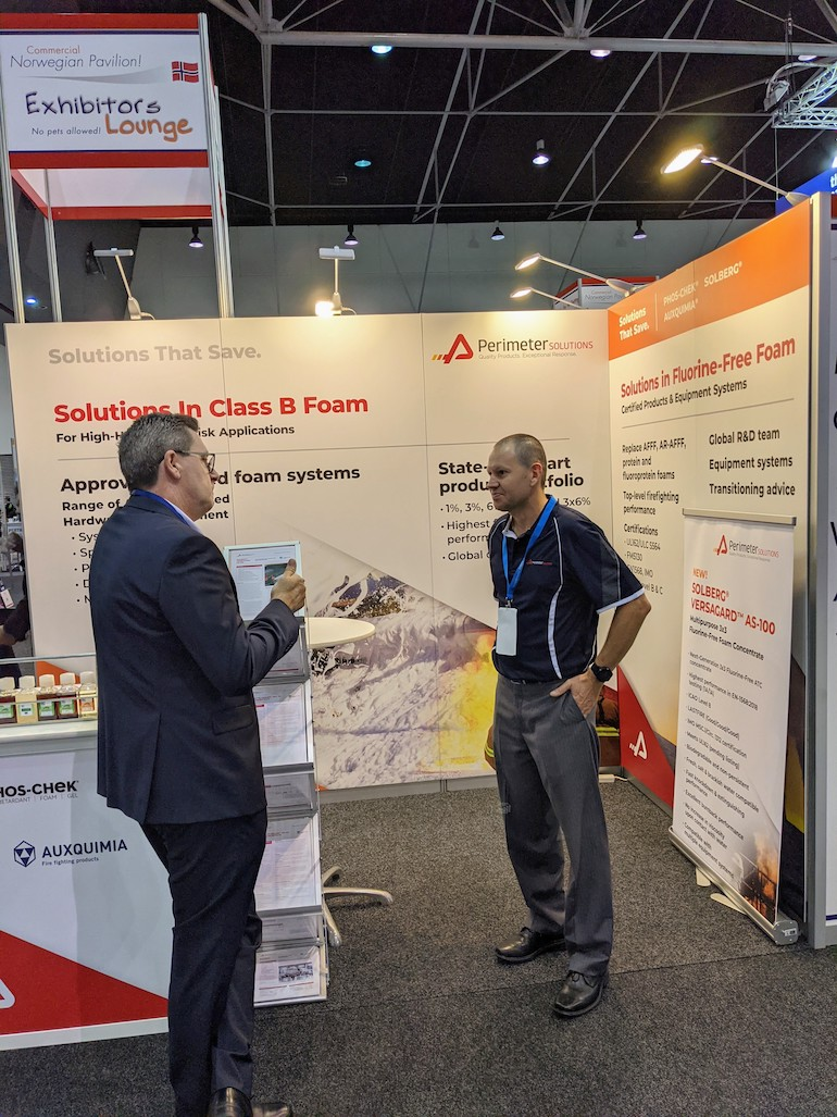 David Phoenix (R) talking to a client on the Perimeter Solutions booth at the AOG Show. (Image copyright: Perimeter Solutions)